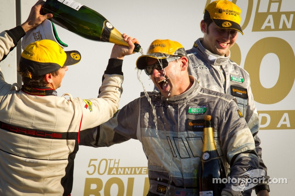 GT podium: Andy Lally has trouble with his champagne bottle