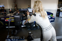 A Sprint girl takes a photo of Jimmie Johnson, Hendrick Motorsports Chevrolet