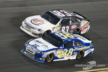 David Gilliland, Front Row Motorsports Ford and Landon Cassill, BK Racing Toyota
