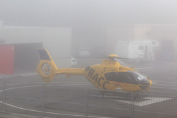 Fog hits the track, medical helicopter