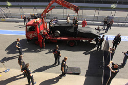 The car of Sebastian Vettel, Red Bull Racing is taken back to the pits after stopping on the track
