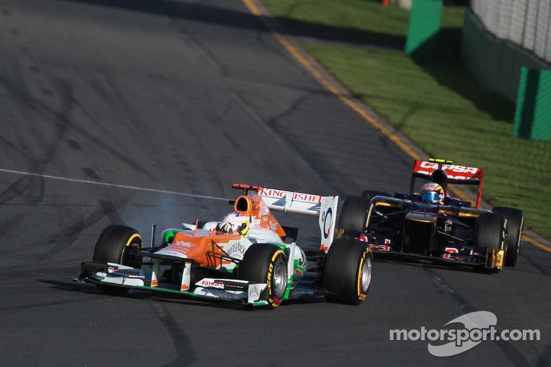 Paul di Resta, Sahara Force India Formula One Team leads Jean-Eric Vergne, Scuderia Toro Rosso