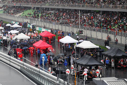 Cars on the grid as the race is stopped during a thunderstorm