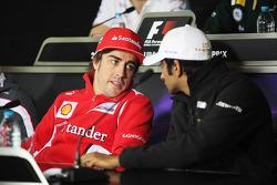 Fernando Alonso, Scuderia Ferrari with Narain Karthikeyan, Hispania Racing F1 Team, in the FIA Press Conference