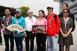 Bernie Ecclestone, CEO Formula One Group, with locals