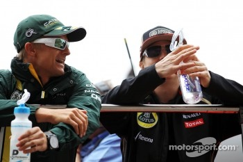 Heikki Kovalainen, Caterham F1 Team with Kimi Raikkonen, Lotus F1 Team on the drivers parade