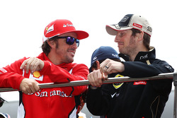 Fernando Alonso, Scuderia Ferrari with Romain Grosjean, Lotus F1 Team on the drivers parade