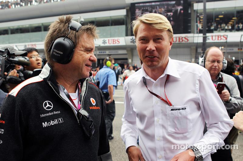 Dr. Aki Hintsa, McLaren Team Doctor with Mika Hakkinen