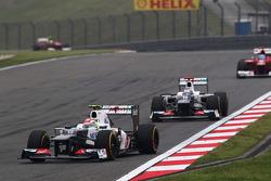 Sergio Perez, Sauber leads team mate Kamui Kobayashi, Sauber