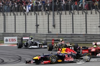 Mark Webber, Red Bull Racing leads Felipe Massa, Ferrari and Romain Grosjean, Lotus F1 and Bruno Senna, Williams