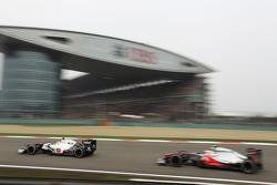 Sergio Perez, Sauber leads Lewis Hamilton, McLaren