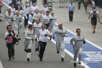Mercedes mechanics run to the podium