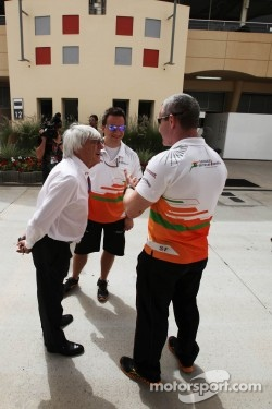 Bernie Ecclestone, CEO Formula One Group, talks with members of the Sahara Force India F1 Team