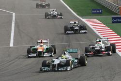 Nico Rosberg, Mercedes AMG F1 leads Nico Hulkenberg, Sahara Force India F1 and Sergio Perez, Sauber