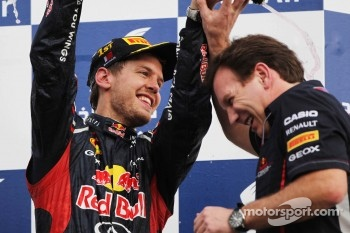 Race winner Sebastian Vettel, Red Bull Racing celebrates on the podium with Christian Horner, Red Bull Racing Team Principal