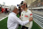 Bernie Ecclestone, CEO Formula One Group, with Romain Grosjean, Lotus F1 Team on the grid