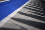 Shadows on the pitlane