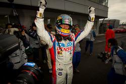 GT500 race winner Hiroaki Ishiura celebrates