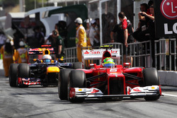 Felipe Massa, Scuderia Ferrari and Sebastian Vettel, Red Bull Racing leave the pits