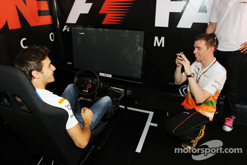 Jules Bianchi, Sahara Force India F1 Team Third Driver and Will Hings, Sahara Force India F1 Press Officer at the Fanzone