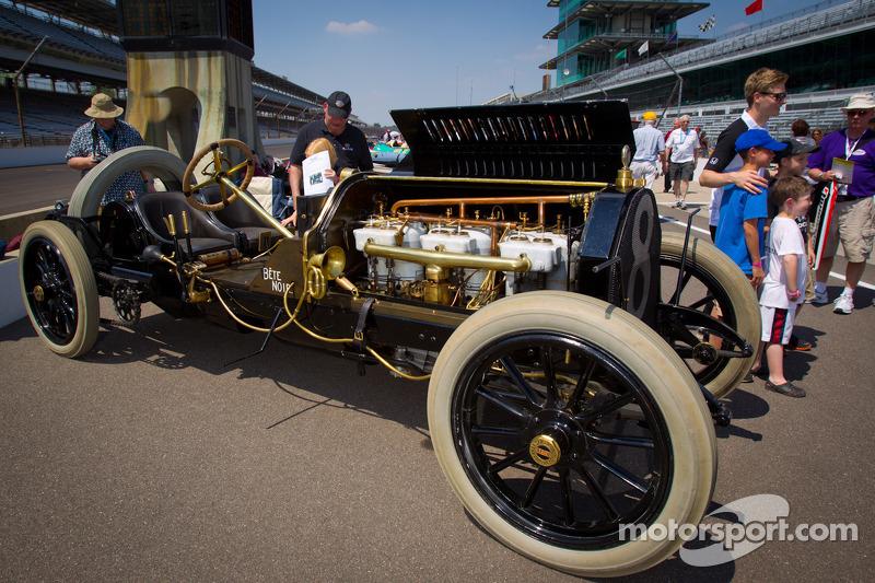 Vintage cars on display on pitlane