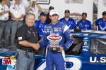 Aric Almirola celebrates pole position