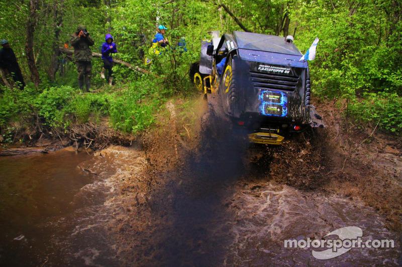 Kari Sihvonen powering out of a river