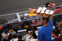 Sebastian Vettel, Red Bull Racing passes a beer seller in the grandstand