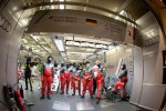 Audi Sport team members get ready for a pit stop