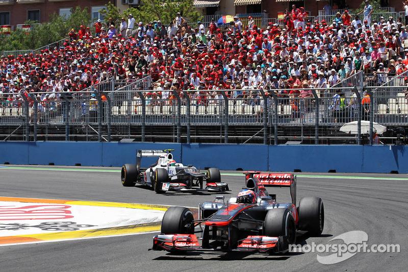 Jenson Button, McLaren Mercedes leads Sergio Perez, Sauber