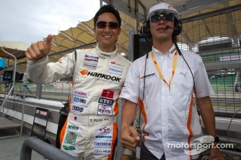 GT300 pole winner Tomonobu Fujii celebrates