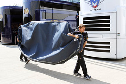 A floor pan for the Red Bull Racing RB8 is carried through the paddock