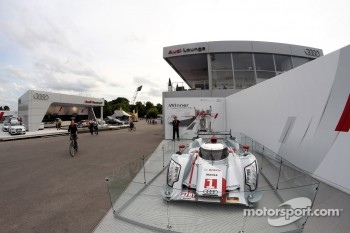 The Le Mans 24 Hours winning Audi R18 E-Tron is shown in front of the Audi Top Service Hospitality Audi VIP Hospitality