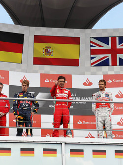 Podium: Sebastian Vettel, Red Bull Racing, second; Fernando Alonso, Ferrari, race winner; Jenson Button, McLaren, third