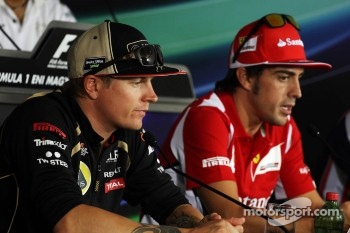 Kimi Raikkonen, Lotus F1 Team and Fernando Alonso, Ferrari in the FIA Press Conference