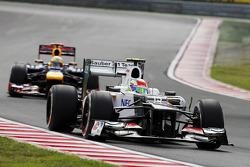 Sergio Perez, Sauber leads Sebastian Vettel, Red Bull Racing