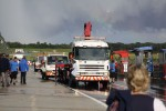 Breakdown trucks in the pitlane