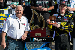 Victory lane: Carl Edwards receives a solid gold Zippo lighter from president Greg Booth