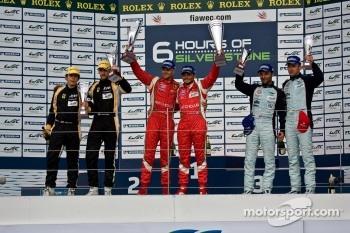 GTE-Pro podium: winners Giancarlo Fisichella, Gianmaria Bruni, second place James Walker, Jonny Cocker, third place Darren Turner, Stefan Mcke