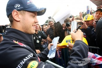 Sebastian Vettel, Red Bull Racing signing autographs for the fans