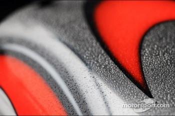McLaren sidepod covered in rain drops
