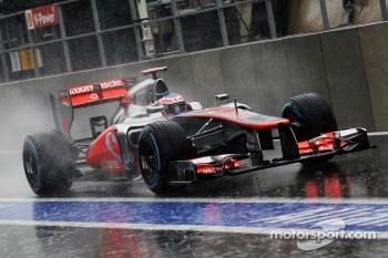 Jenson Button, McLaren leaves the pits