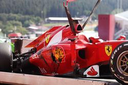The Ferrari of Fernando Alonso, Ferrari is craned away after a crash at the start