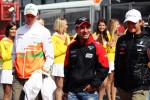 Nico Hulkenberg, Sahara Force India F1 with Timo Glock, Marussia F1 Team and Nico Rosberg, Mercedes AMG F1 on the drivers parade