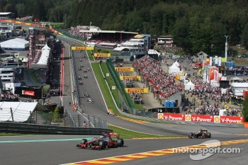 Jenson Button, McLaren Mercedes leads Kimi Raikkonen, Lotus F1 Team after the start
