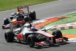 Jenson Button, McLaren leads Sebastian Vettel, Red Bull Racing
