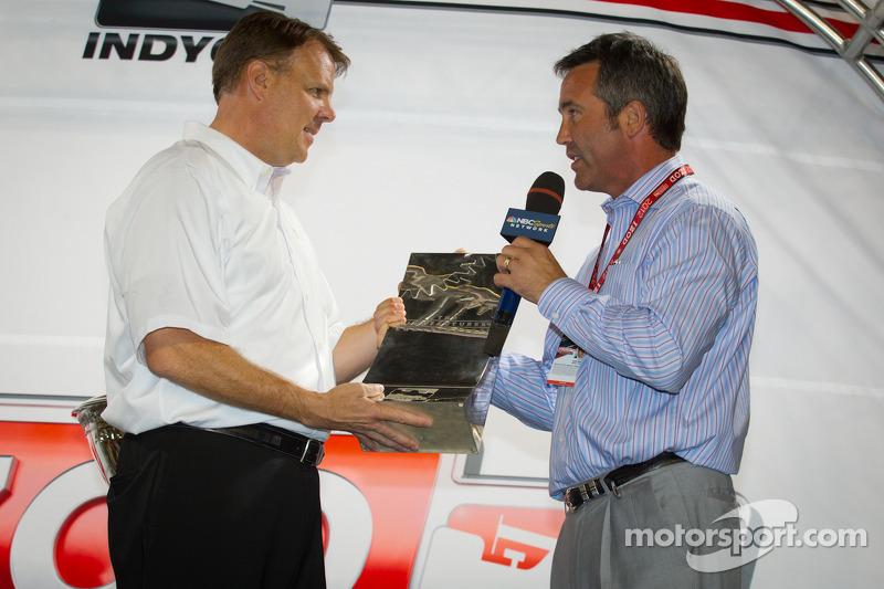 Chief Executive Officer of IndyCar Randy Bernard presents Manufacturer's Award