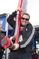 Actor Kevin James tries out a fuel can