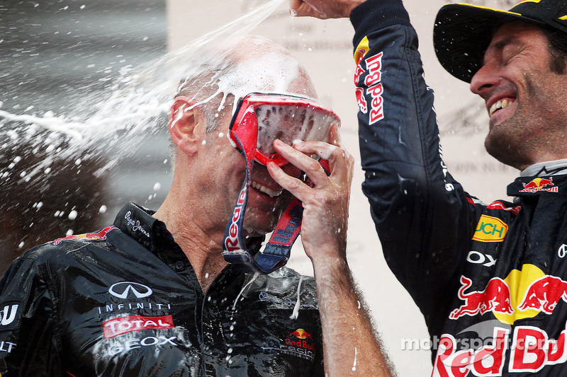 Adrian Newey, Red Bull Racing Chief Technical Officer celebrates on the podium with second placed Mark Webber, Red Bull Racing