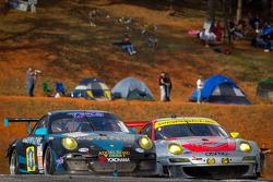 #68 TRG Porsche 911 GT3 Cup: Emmanuel Collard, Manuel Gutierrez, Mike Hedlund, #45 Flying Lizard Motorsports Porsche 911 GT3 RSR: Jörg Bergmeister, Patrick Long, Patrick Pilet